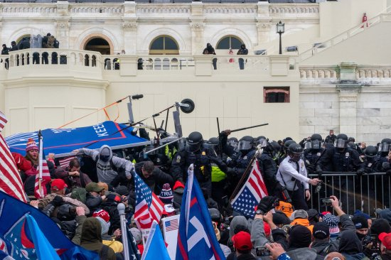 2020.Washington DC. USA. Protestors clash with police before gaining entry to the capitol. Following an inflammatory speech by President Trump, protestors objecting to the certification of Joe Biden by Congress storm the Capitol. They were briefly blocked by police before gaining entry, and wreaked havoc before being expelled with few arrests. One protestor was shot and killed.